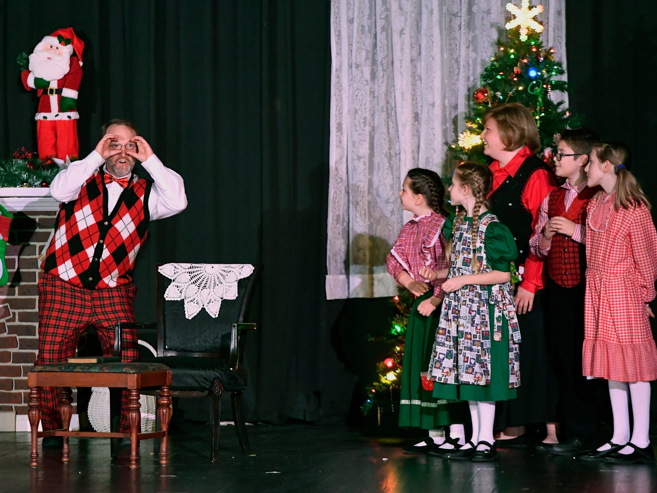 """Bob Arvin, left, portraying a father, and his stage family sing """"Rudolph the Red-Nosed Reindeer"""" during a dress rehearsal for the Theater Arts for Everyone performance of """"The Night Before Christmas."""" Show times are Dec. 7 and 8 at 7 p.m. and Dec 8 and 9 at 3 p.m.  at the York Learning Center. Tickets are available at the door or through Eventbrite. Thursday, December 6, 2018.  John A. Pavoncello photo"""