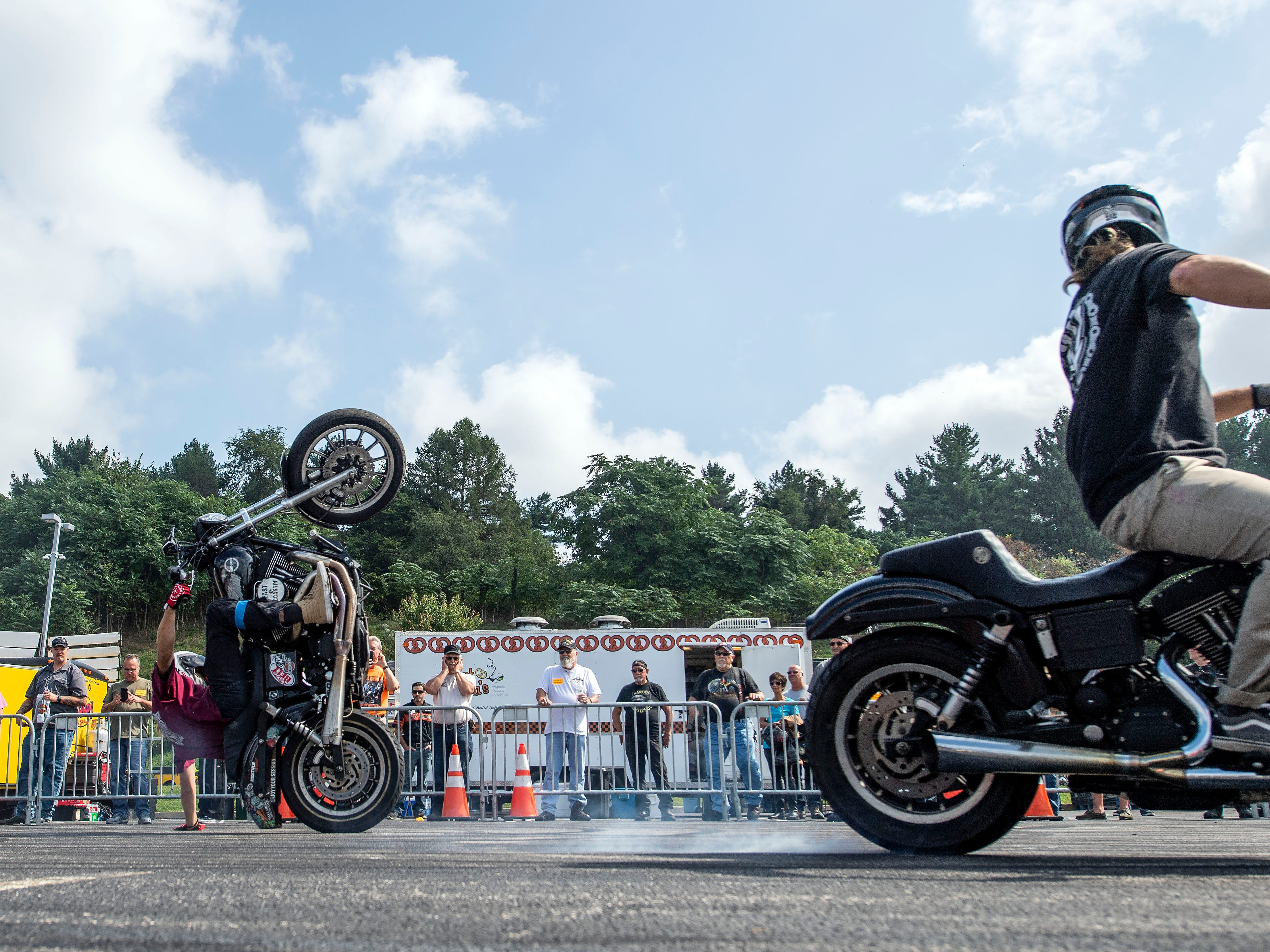Joey Robinson does a one-handed wheely during the Ives Brothers stunt show at Harley-Davidson, Thursday, September 20, 2018. Motorcycle enthusiasts flooded into Harley-Davidson to tour the production plant, see the newest models of bikes and watch stunt shows to lead up to the 24th annual York Bike Night, on Sept. 22.
