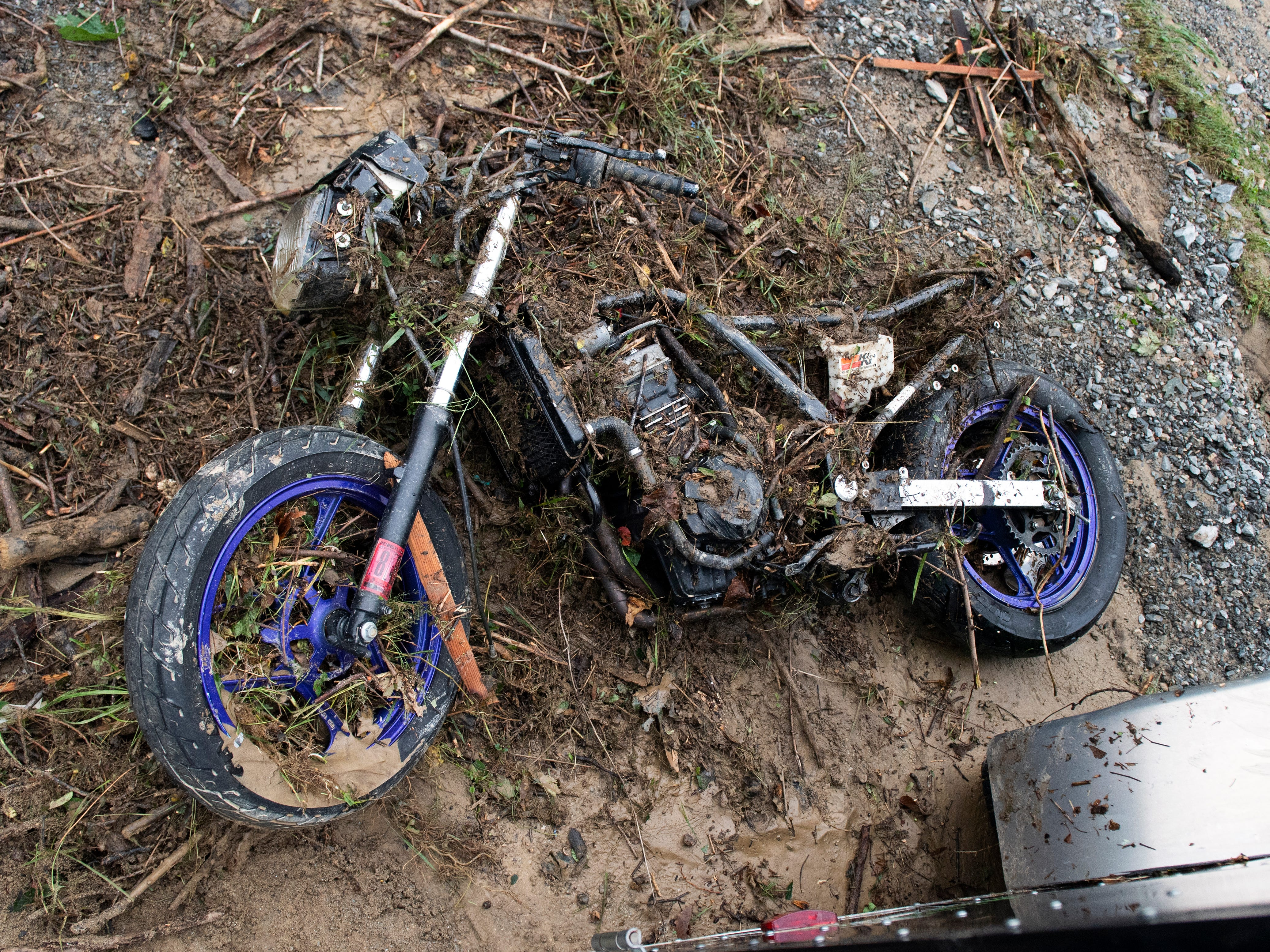 Mike Bray's 1996 250 Ninja lays mangled on the ground after he pulled it out from under a trailer, Saturday, September 1, 2018. Heavy rains flooded on Friday night flooded much of York County, leaving many roads closed and some destroyed.