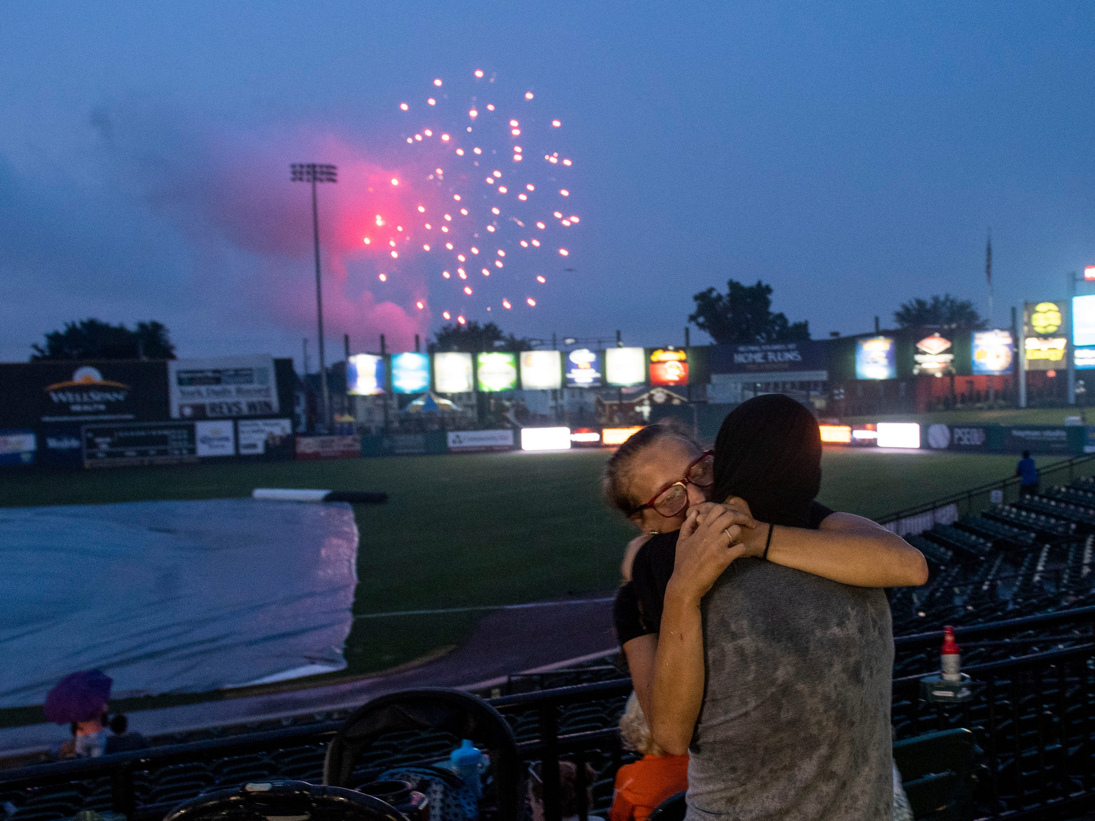 A couple embraces during fireworks at PeoplesBank Stadium following the York Revolution game, Wednesday, July 4, 2018.