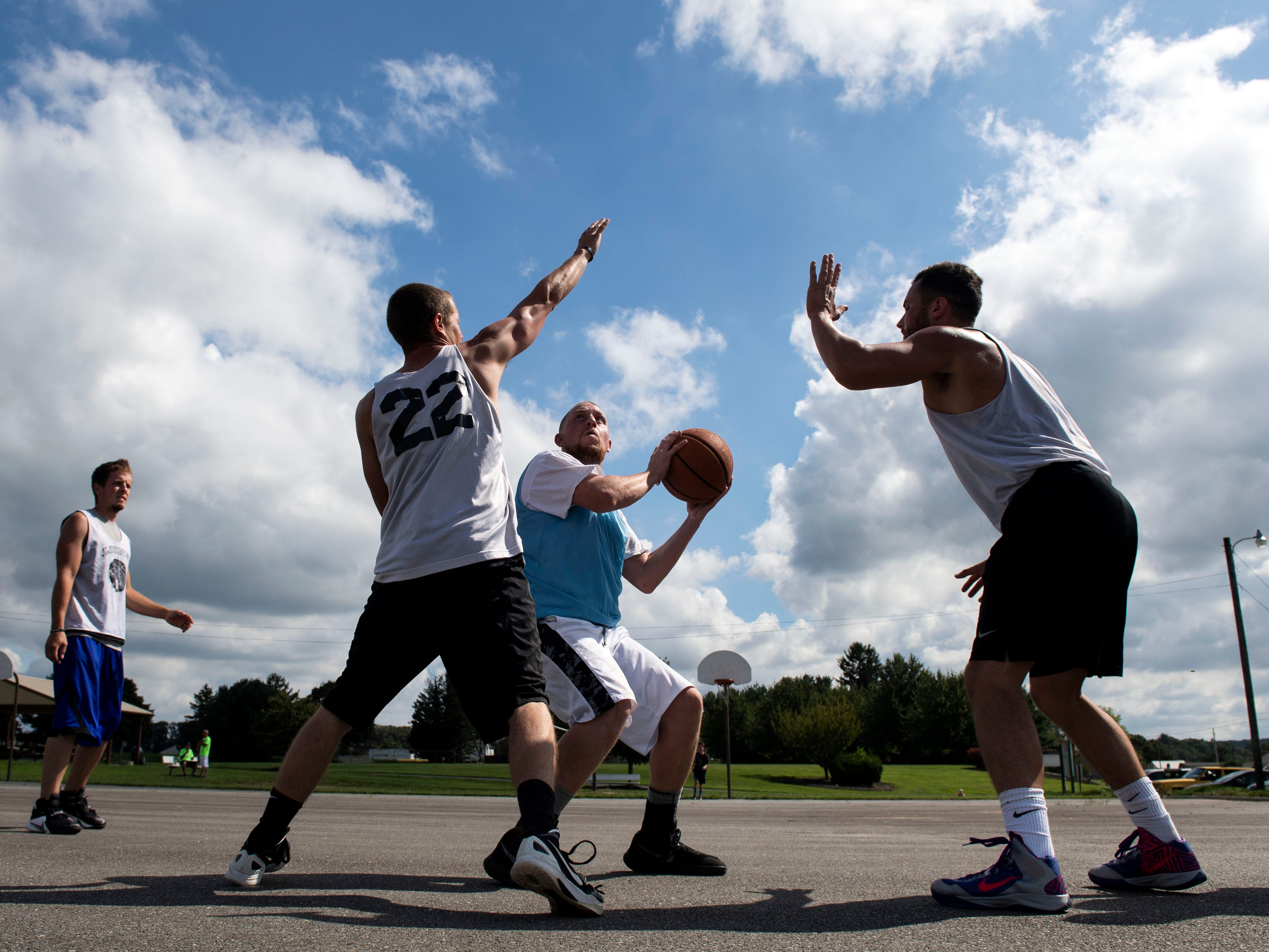 R.J. Stoutzenberger, center, gets ready to shoot during the championship game of the 'Don't Hate the Race' 3-on-3 tournament on Saturday, September 15, 2018. The 3-on-3 tournament was put on to honor Chad Merrill, who was shot and killed on July 21 outside the Red Rose Restaurant.