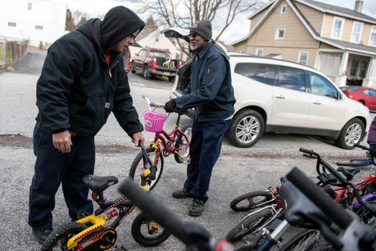 Manuel Marinez, left, of Family First Health, and James Harris, of the Salvation Army pick out children's bikes for their respective charities from the lot at Gung Ho Bikes, Friday, Dec. 7, 2018. 'It's a beautiful thing they've got here,' said Harris. The bike shop donated nearly 150 bikes to local charities for the fifth year in a row.