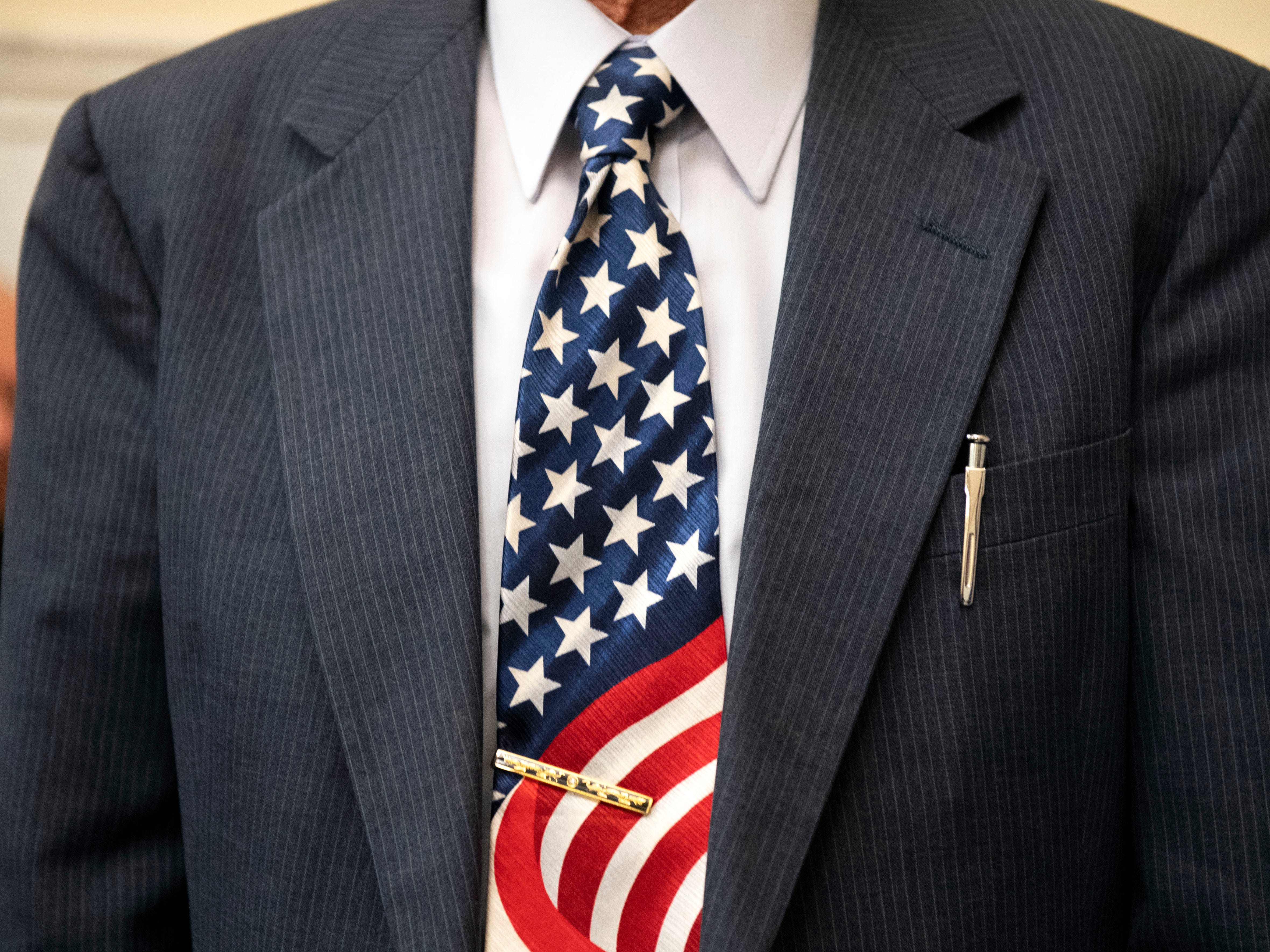 Mien Dinh Nguyen, originally from Vietnam, shows off his American flag themed tie during a naturalization ceremony at the York County Administration Center, Thursday, Oct. 25, 2018. Nguyen has taken the citizenship test six times, failing five, and finally became a U.S. citizen on Thursday. during a naturalization ceremony at the York County Administration Center, Thursday, Oct. 25, 2018. The 49 new citizens immigrated from 30 different countries.