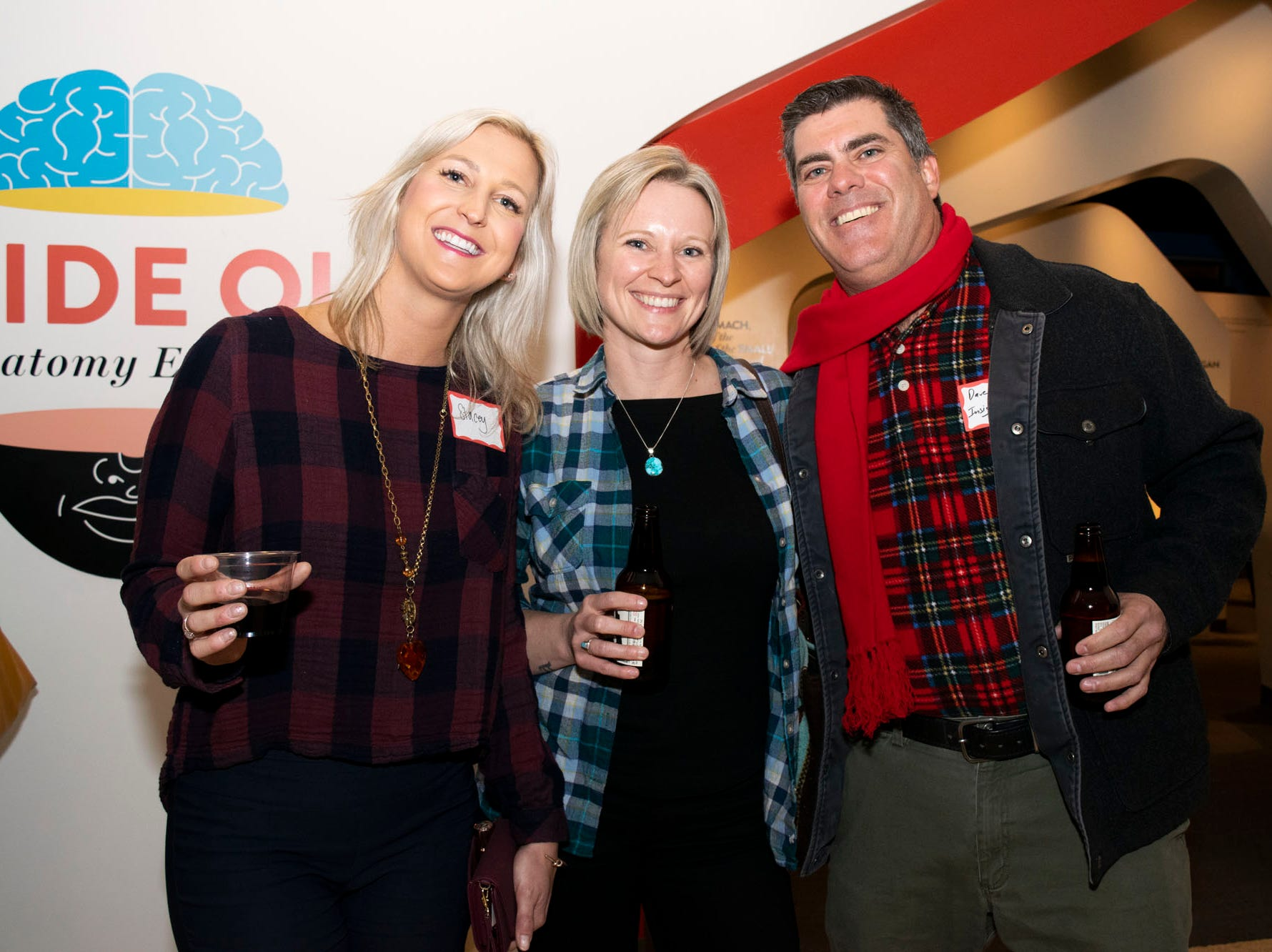 Stacey Sunday, Kristin McClellan, and Dave Siegal attend Mingle Bells 2018 at the Discovery Museum on Thursday, Dec. 6, 2018. Reno, Nev.