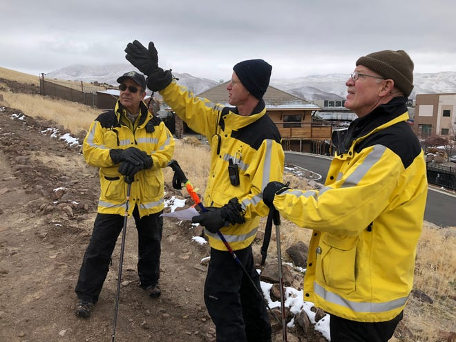 Search and rescue personnel Joe Petralia, Brian Block and Dave Gabany, volunteers with the Washoe County Sheriff's Office, discuss their search for a missing person on Thursday, Dec. 6, 2018 south of Reno. The following day, two search and rescue officers found a body nearby. It was not immediately clear if that body was connected with the original missing-person search, according to the sheriff's office.