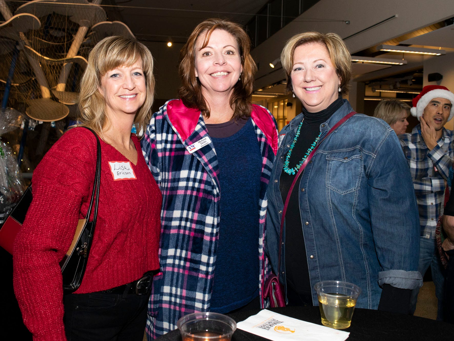 Lisa Ericson, Melissa Dietz, and Maura Kenney attend Mingle Bells 2018 at the Discovery Museum on Thursday, Dec. 6, 2018. Reno, Nev.
