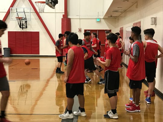 The Wooster boys basketball team practices Thursday. The Colts beat Reno, 45-43, on Wednesday.