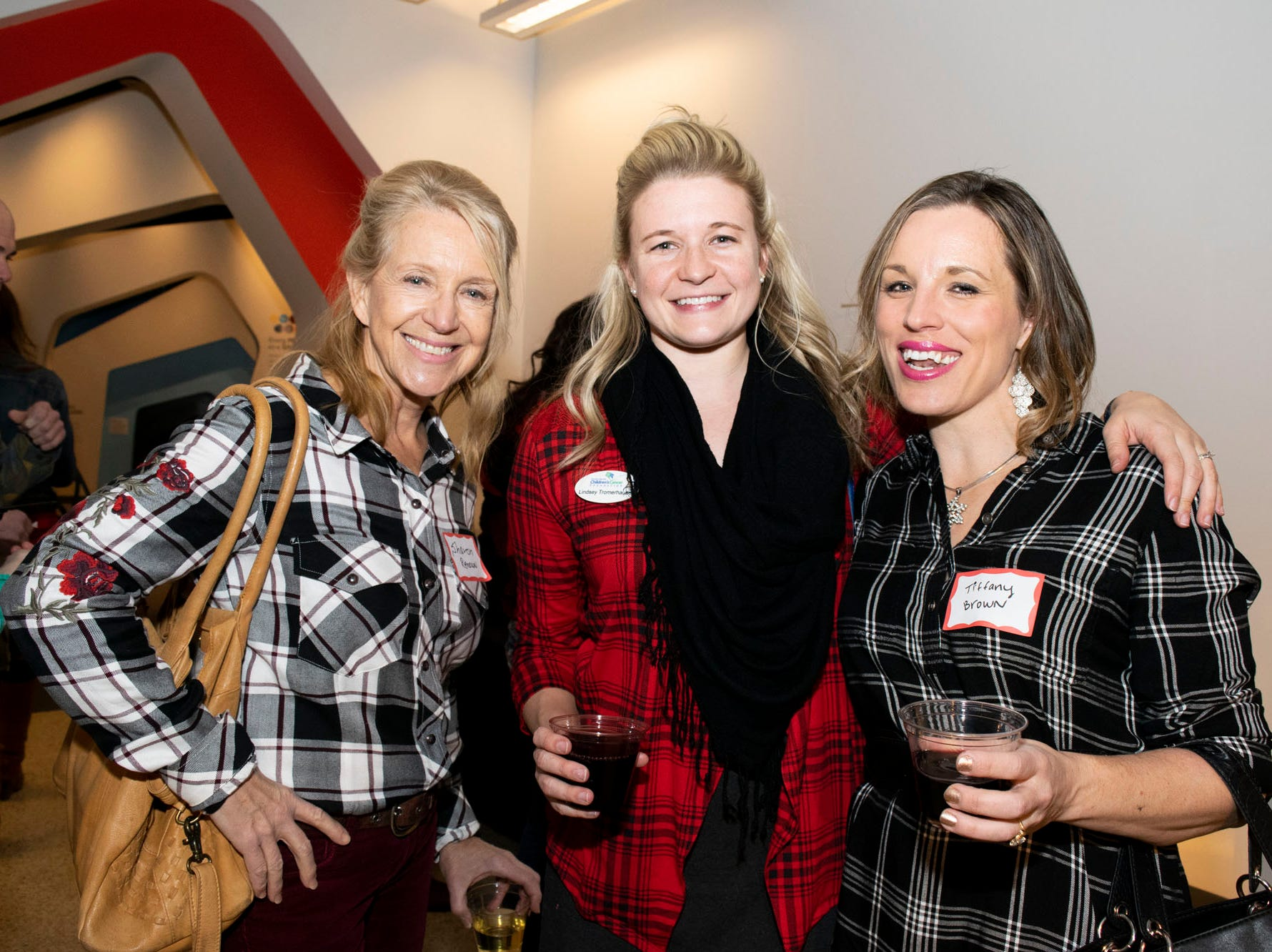 Sharon Spangler, Lindsey Tromerhauser, and Tiffany Brown attend Mingle Bells 2018 at the Discovery Museum on Thursday, Dec. 6, 2018. Reno, Nev.