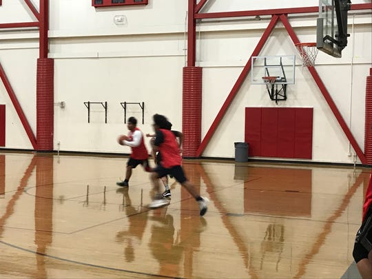The Wooster boys basketball team practices Thursday. The Colts beat Reno, 45-43 on Wednesday.