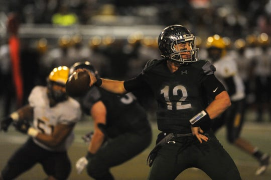 Damonte Ranch's Cade McNamara looks to throw while taking on Bishop Manogue during their northern region championship football game in Reno on Nov. 16, 2018.