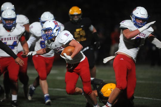 Reno's Drue Worthen looks for room to run against Bishop Manogue during their playoff football game at Manogue on Nov. 2.