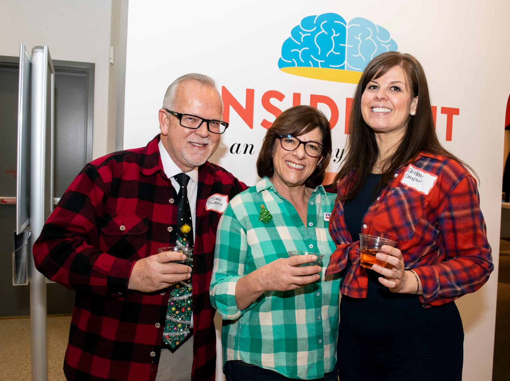 John Murphy, Esther Isaac, and Candee Candler attend Mingle Bells 2018 at the Discovery Museum on Thursday, Dec. 6, 2018. Reno, Nev.