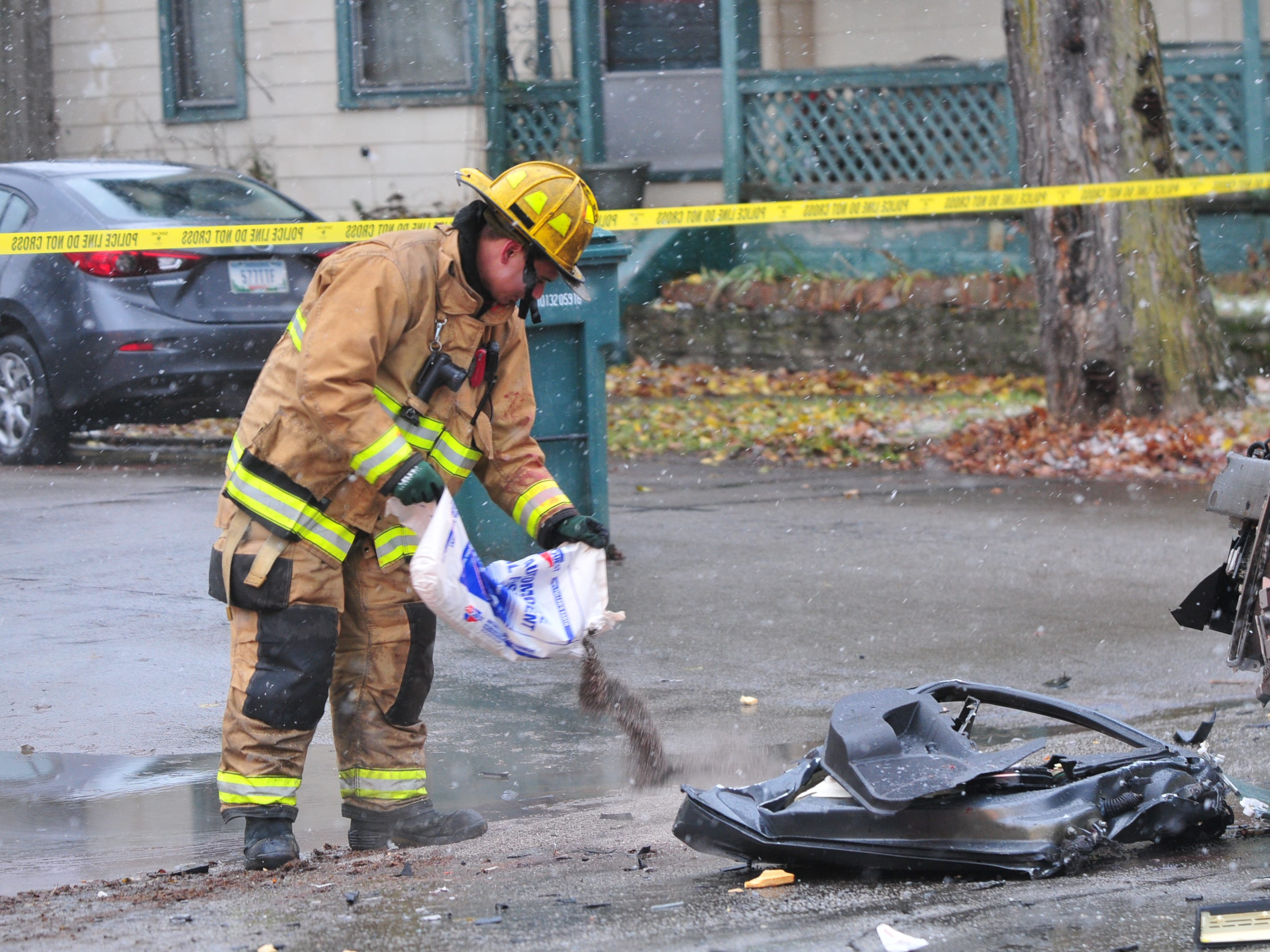 A substance is deployed to absorb fluids Thursday at an accident scene on Richmond Avenue.