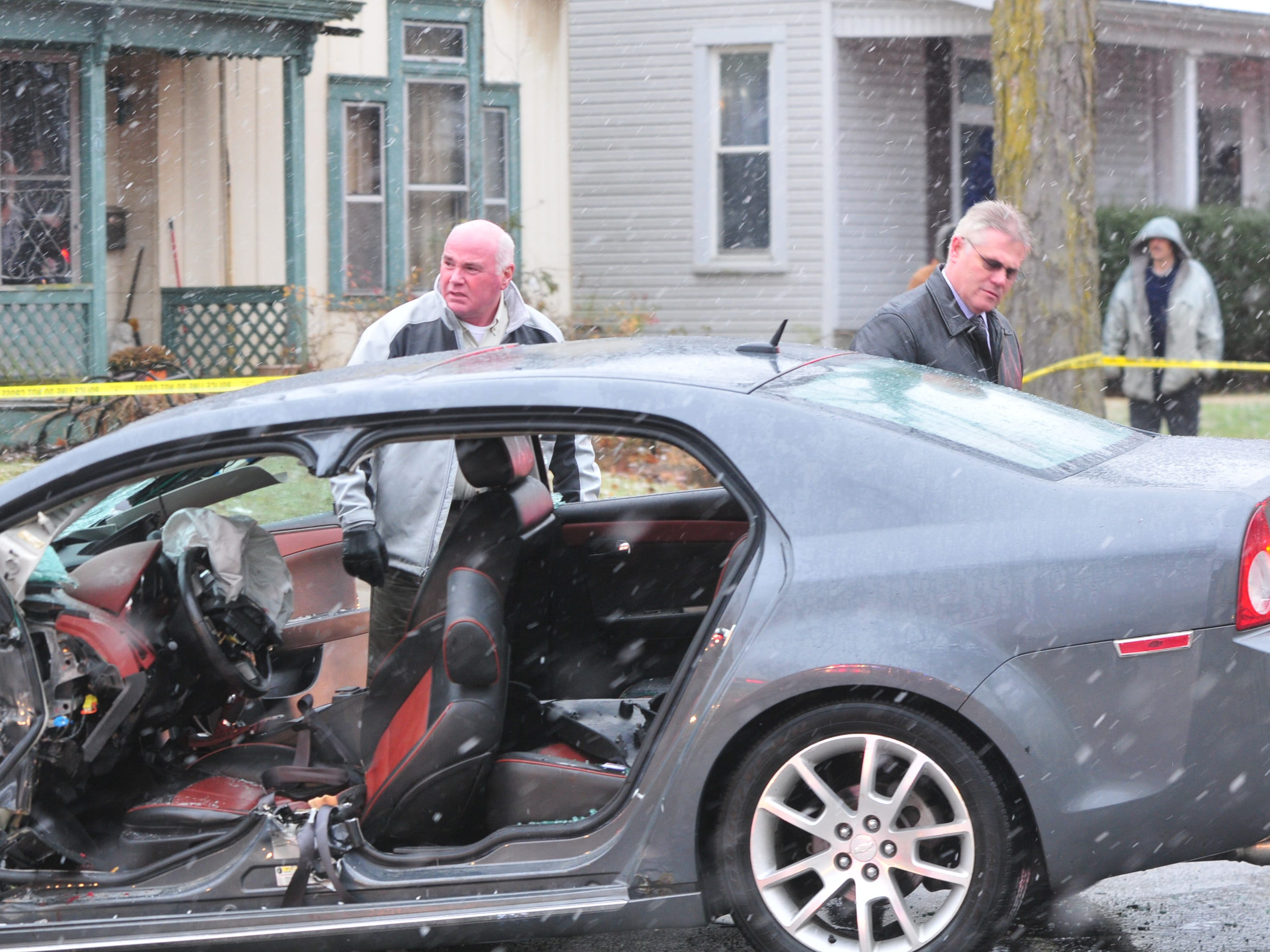 Detective Tom Legear and Lt. Donnie Benedict investigate at the scene of a two-vehicle accident Thursday on Richmond Avenue.