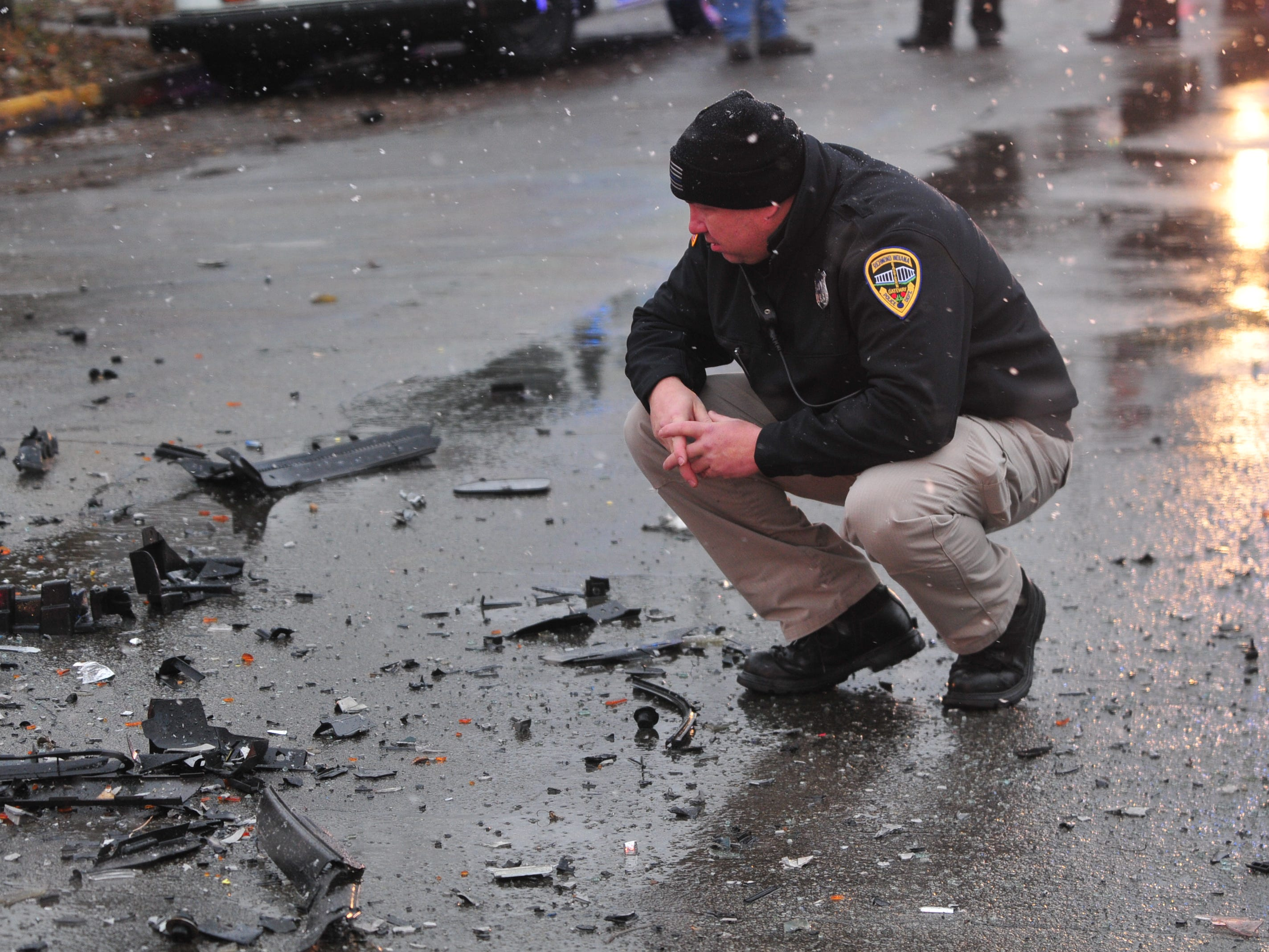 Officer Danny Barron surveys the scene of an accident Thursday on Richmond Avenue.