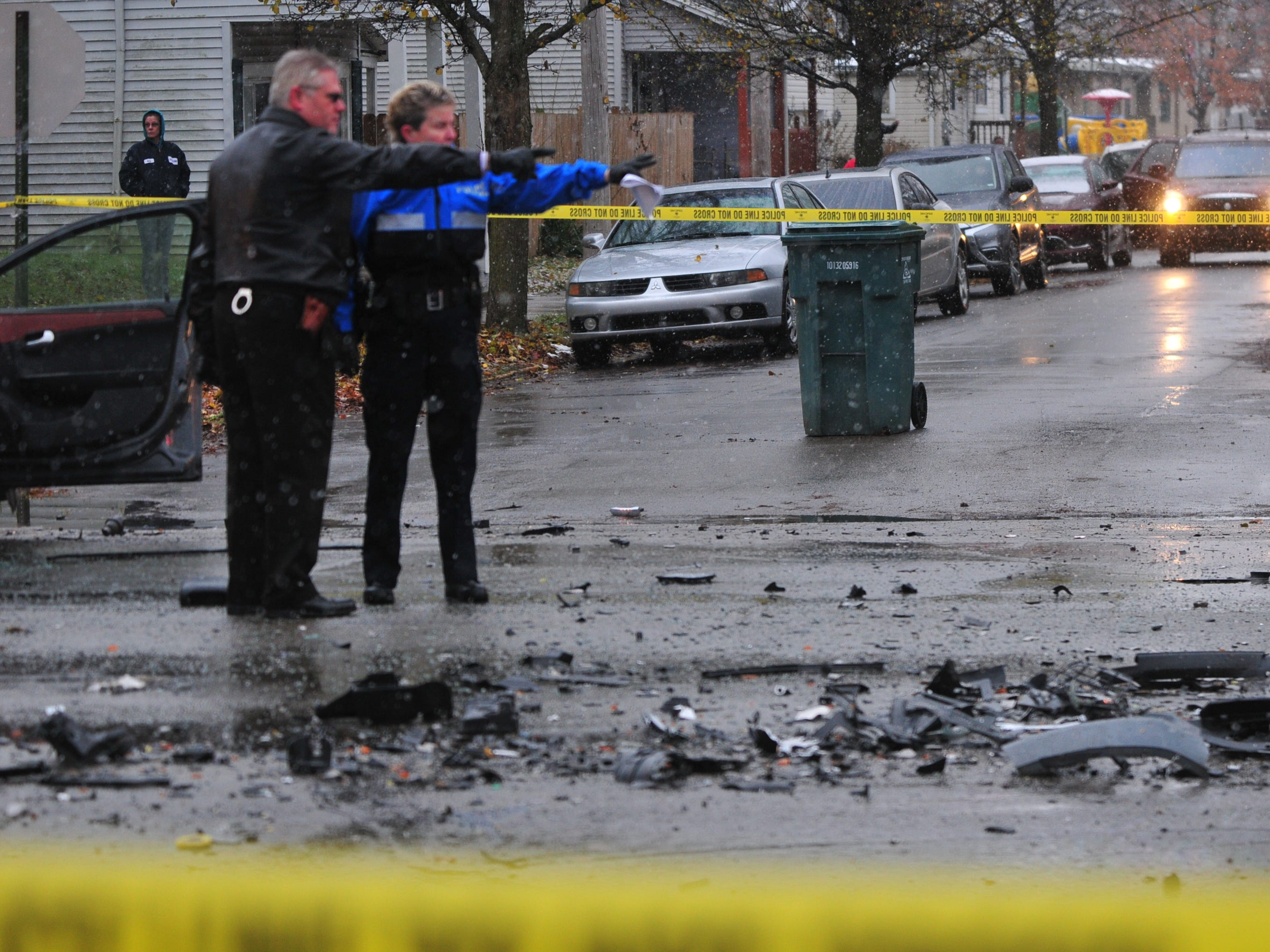 Lt. Donnie Benedict and Officer Ami Miller discuss an accident scene Thursday on Richmond Avenue.