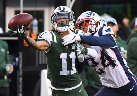 New York Jets wide receiver Robby Anderson can't hang on to a 4th quarter pass as New England Patriots cornerback Stephon Gilmore defends.