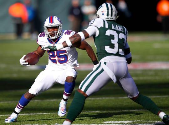 Buffalo Bills running back LeSean McCoy runs for yardage against New York Jets strong safety Jamal Adams.
