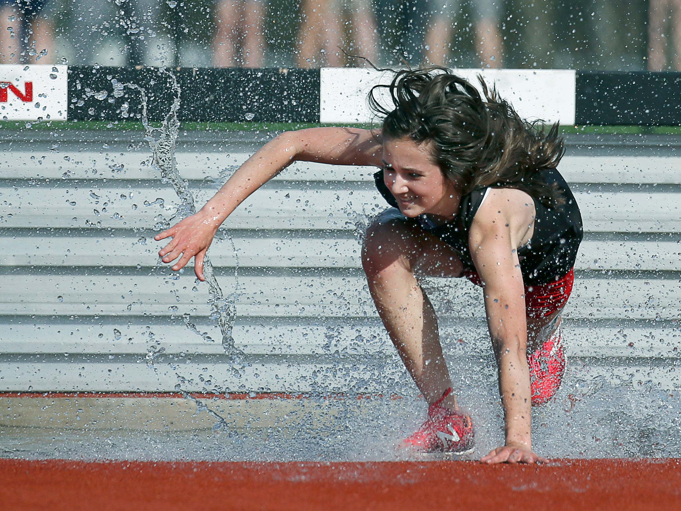 Hilton's Sabrina Antonini won the steeplechase with a time of 8:11.38 during the Runnin' Cadet Classic at Hilton High School. This is one of the toughest races in track with the added drama of the water jump. It's an event I was hoping to cover, the water here is the equivalent to me of getting that bunker shot in golf.