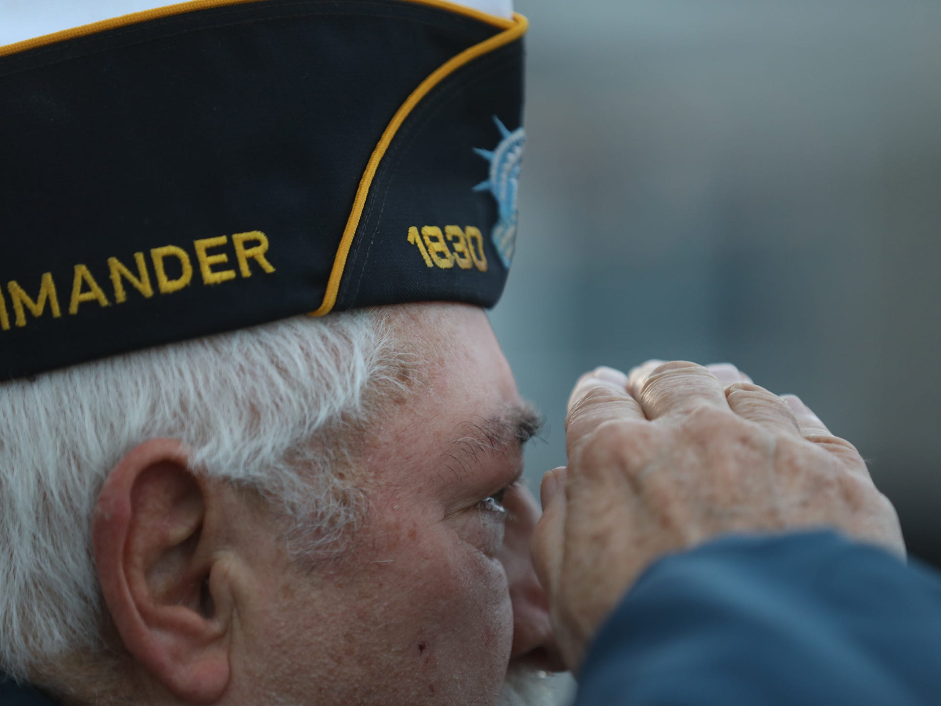 Maurice Arthur, with the Chili American Legion Post 1830, salutes during the singing of the National Anthem.