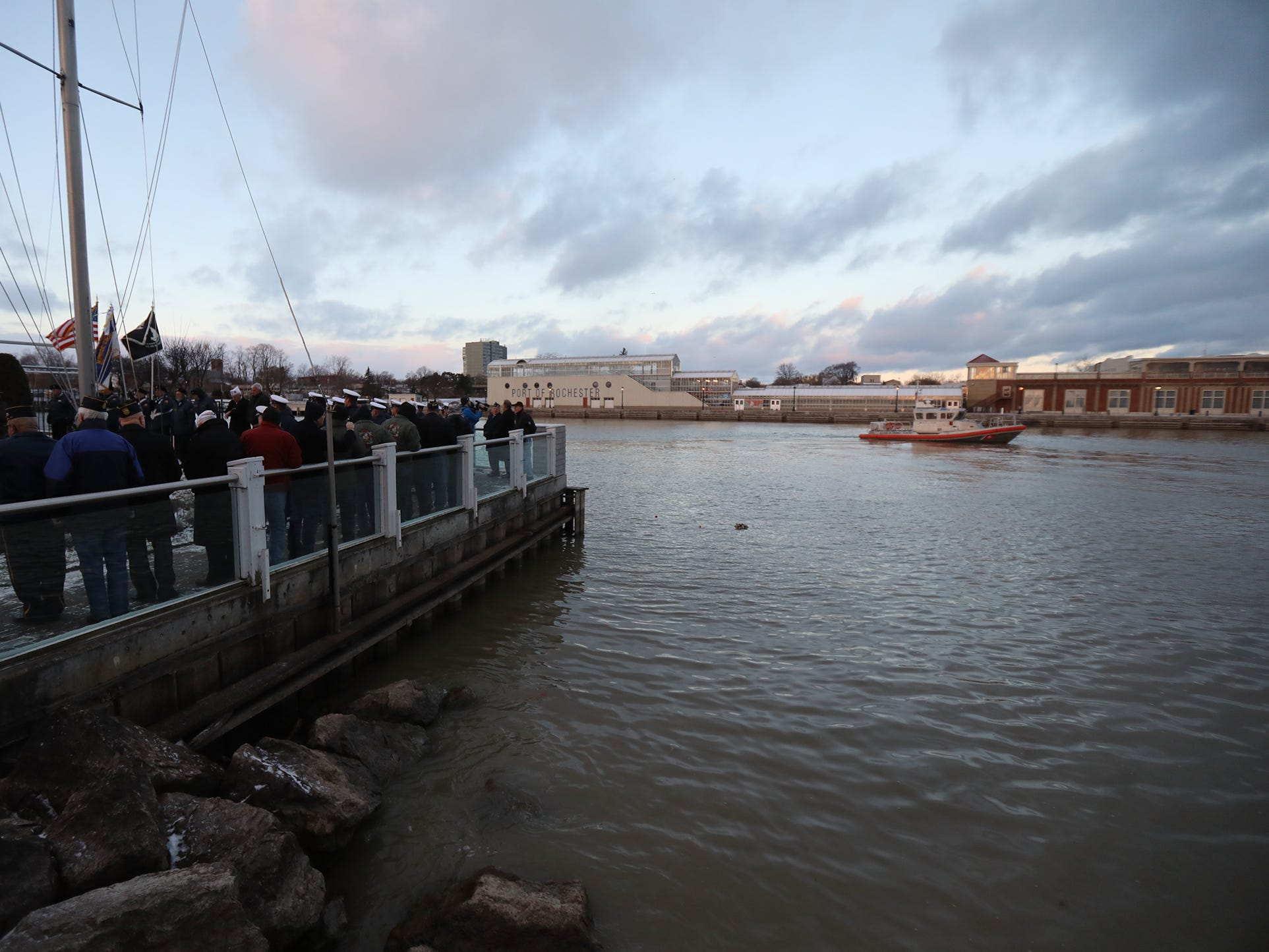 A wreath was thrown into the Genesee River to honor those who died at Pearl Harbor.