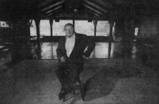 In 1992, co-owner Brian Berg sits in the Russet Room of the Apple Grove Inn nearly a year after a fire caused extensive damage. Co-owner Jeff Wagner was working in another restaurant to pay the bills until Apple Grove could reopen.