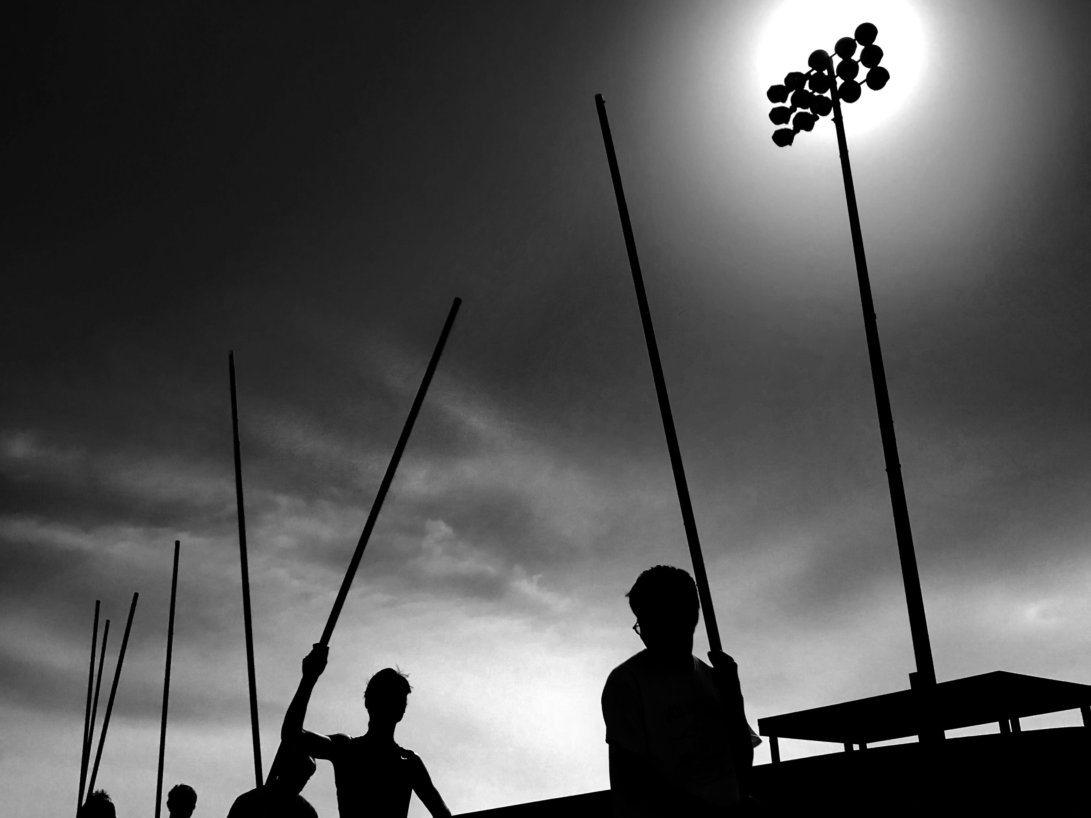 Pole vaulters warm up during the Runnin' Cadet Classic at Hilton High School.  As soon as I saw the pole vaulters against the sky it reminded me of a jousting tournament and horsemen waiting with their lances.