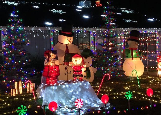 This display at 5729 Old Barn Way in Redding won third place in the Realtors' individual home/best classical category.