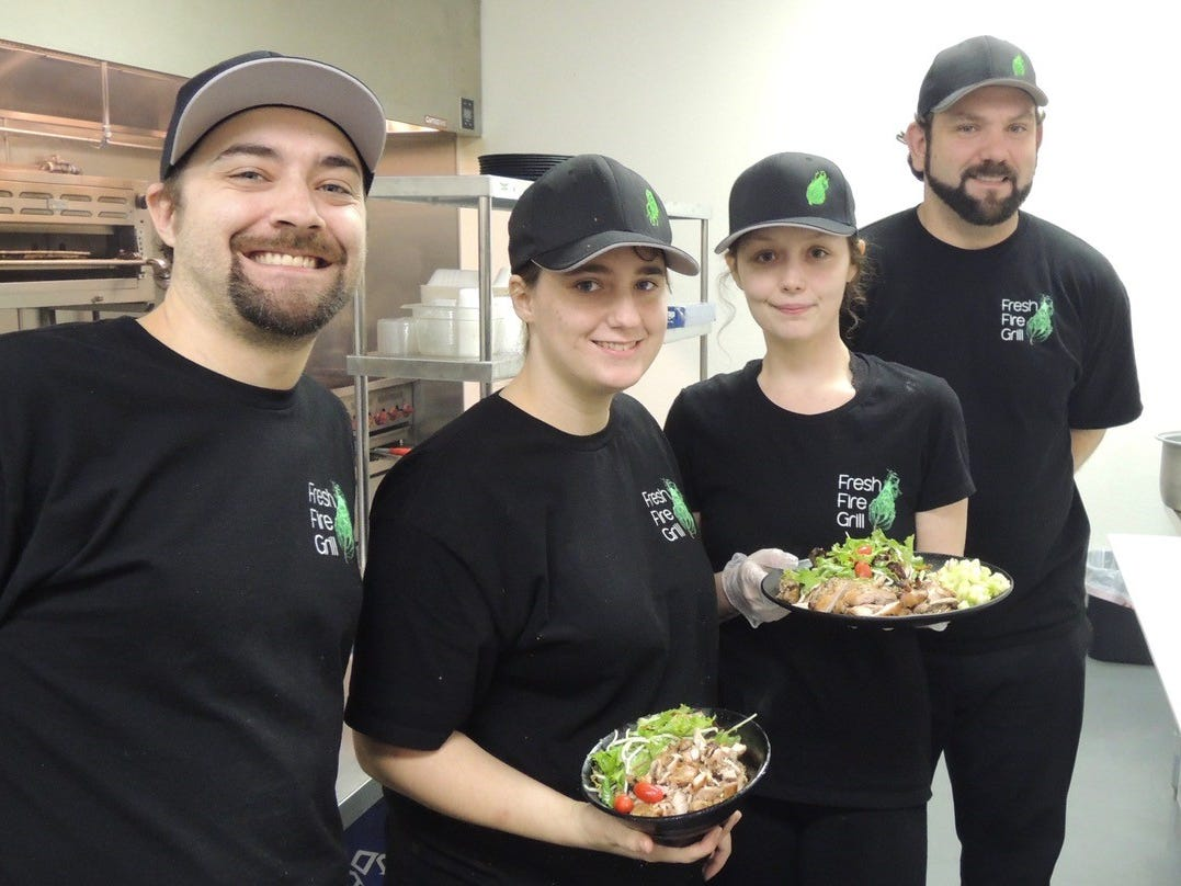 Some of the staff at the new Fresh Fire Grill in Redding: Eric Suter, left, Laura Peyton, Destiny Wood and Levi Silva.