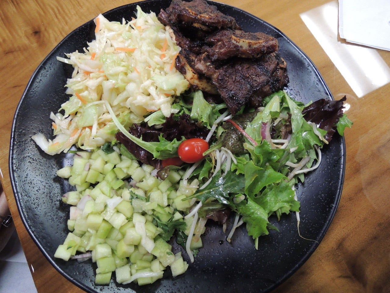 Korean barbecue ribs with Asian slaw and salad at Fresh Fire Grill's new location on Lake Boulevard.