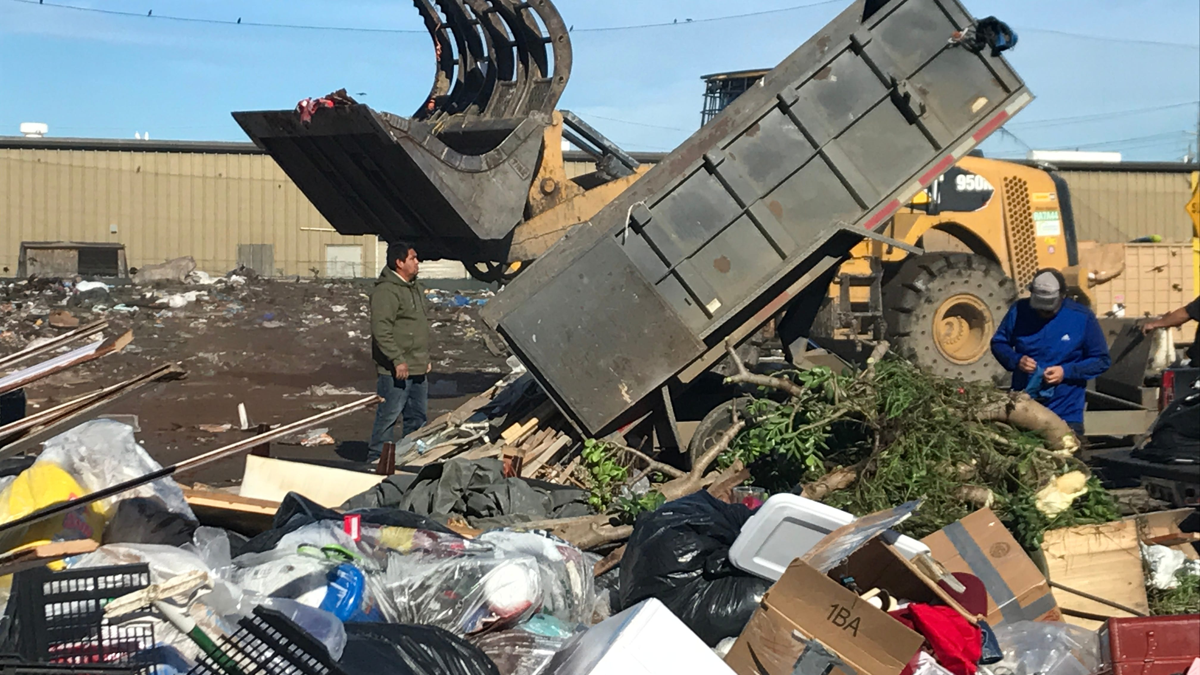 A man was picked up in a waste container and dumped at a Salinas garbage transfer station. The man was dumped as part of a load from a dump trailer, like the one in the foreground.