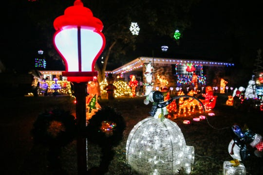 The yard at 3306 Cumberland Drive in the College Hills neighborhood near Unidad Park is a celebration of lights all by itself, from Disney characters to Santa's sleigh — the display has it all.