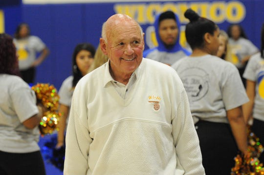 Wi-Hi head coach Butch Waller smiles as his team gets set to take on Cambridge South-Dorchester on Thursday, Dec. 6, 2018 to open up the high school basketball season. Wi-Hi won, 77-57.