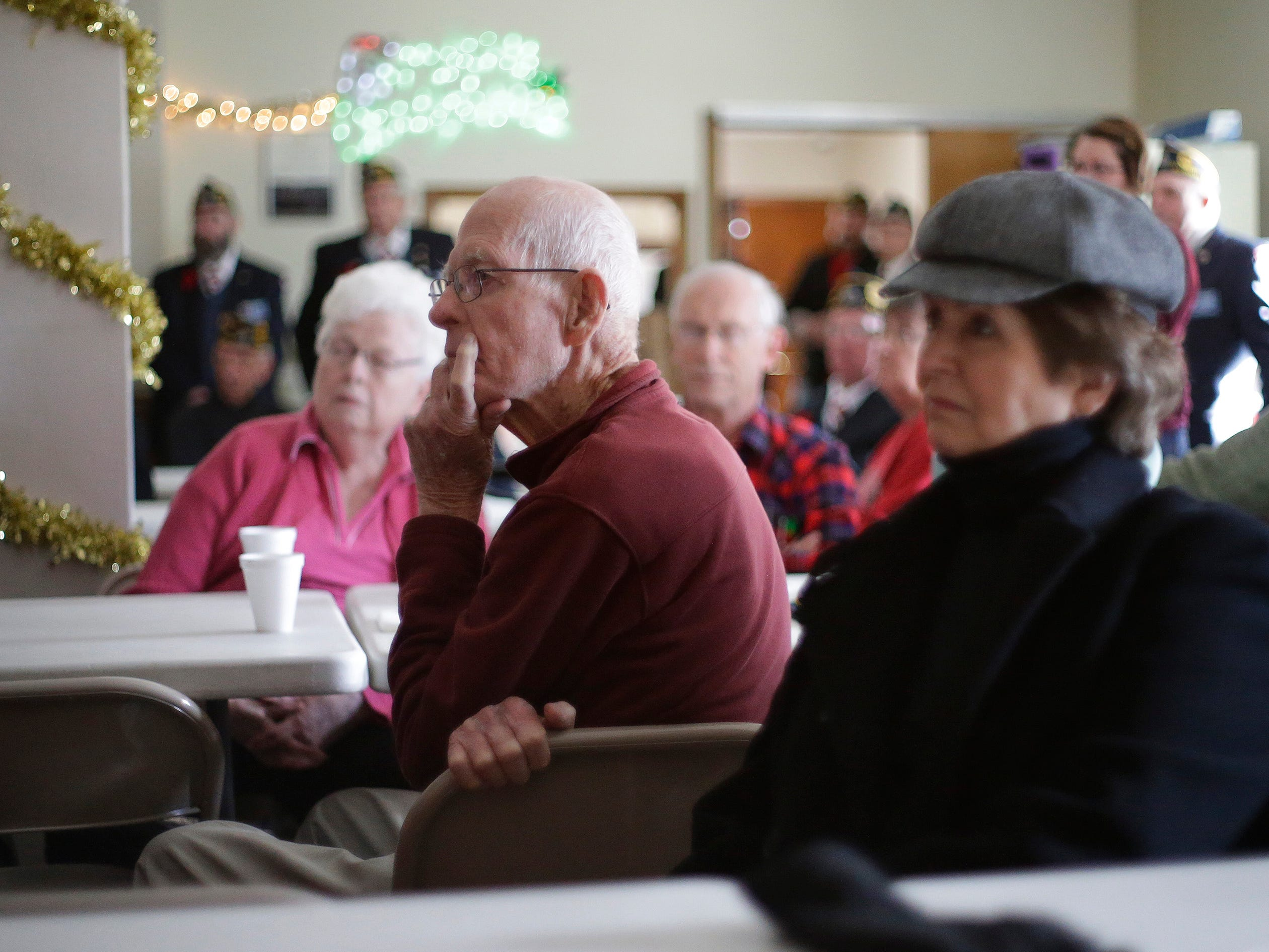 People listen and watch a DVD about Pearl Harbor at American Legion Post 243, Friday, December 7, 2018, in Plymouth, Wis.