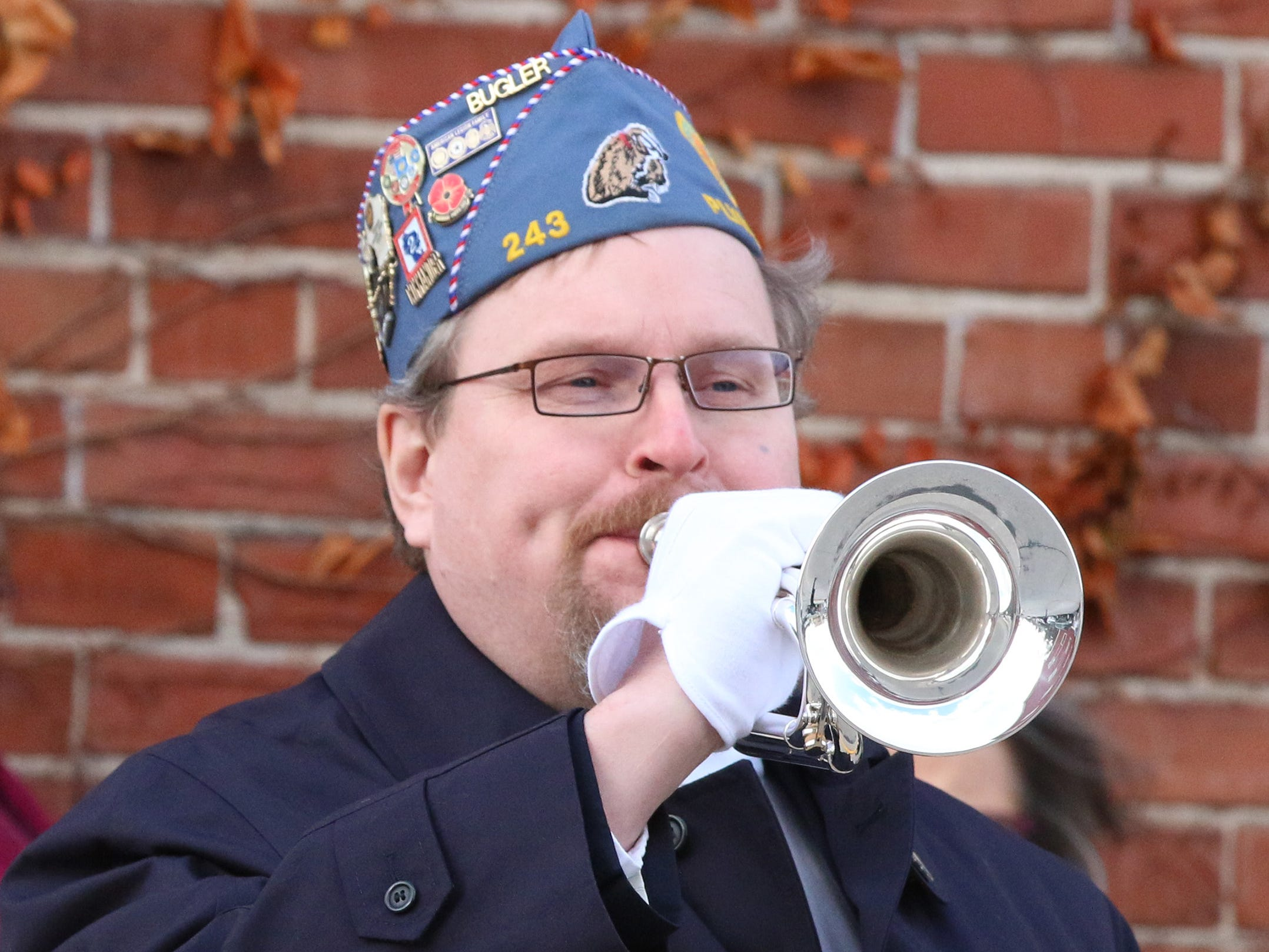 American Legion, Ladwig-Zinkgraf Post 243's Michael Kalsbeek performs Taps during the Pearl Harbor program, Friday, December 7, 2018, in Plymouth, Wis.