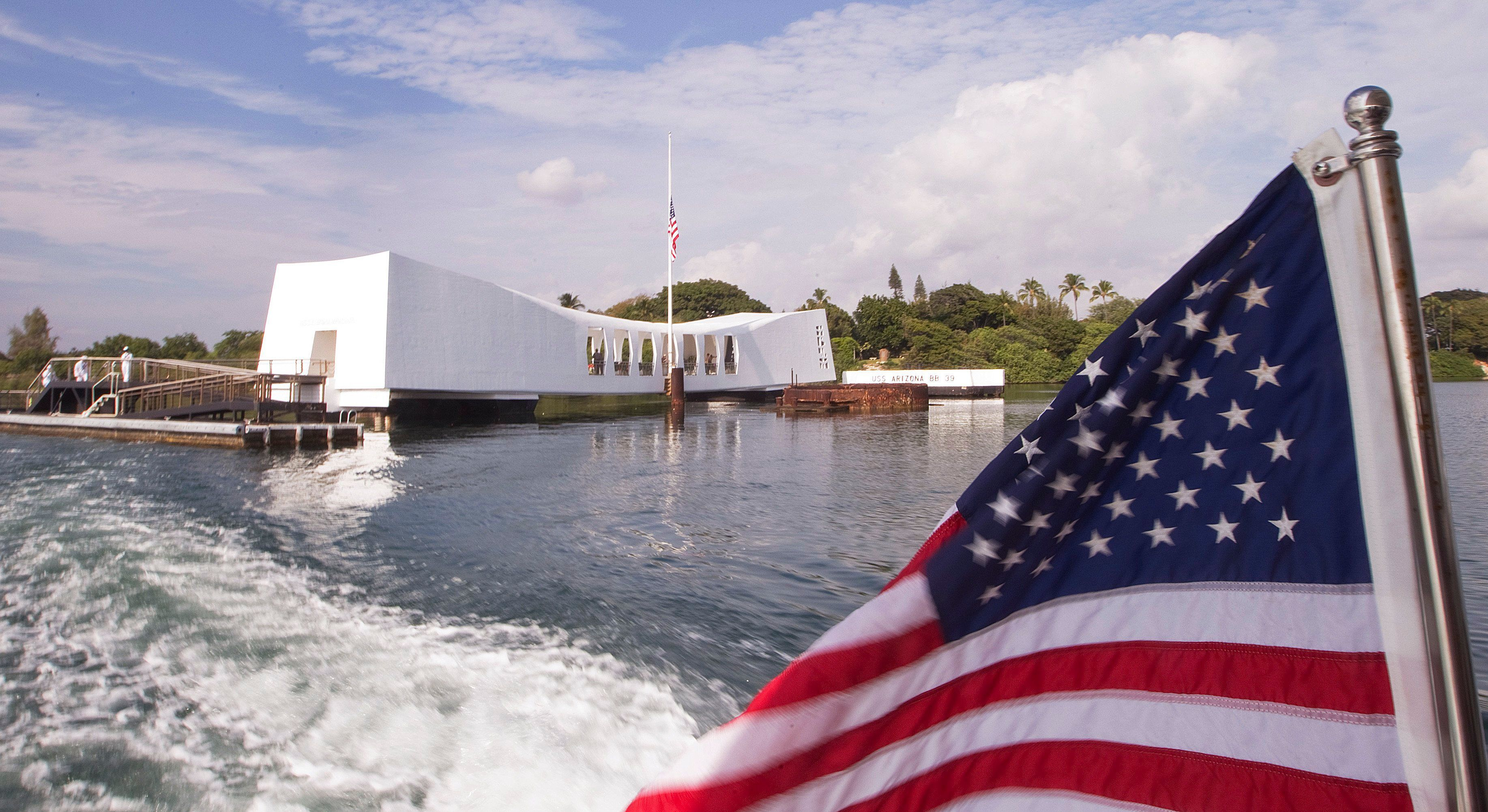 This Dec. 7, 2012 file photo shows the the USS Arizona Memorial at Pearl Harbor, Hawaii. The National Park Service on Friday, Aug. 7, 2015 said it was naming the superintendent of national parks in the Seattle area to oversee the USS Arizona Memorial, which has been rocked by the alleged ticket sales even though people aren't ever supposed to pay to visit the solemn site honoring World War II dead. (AP Photo/Eugene Tanner, File)