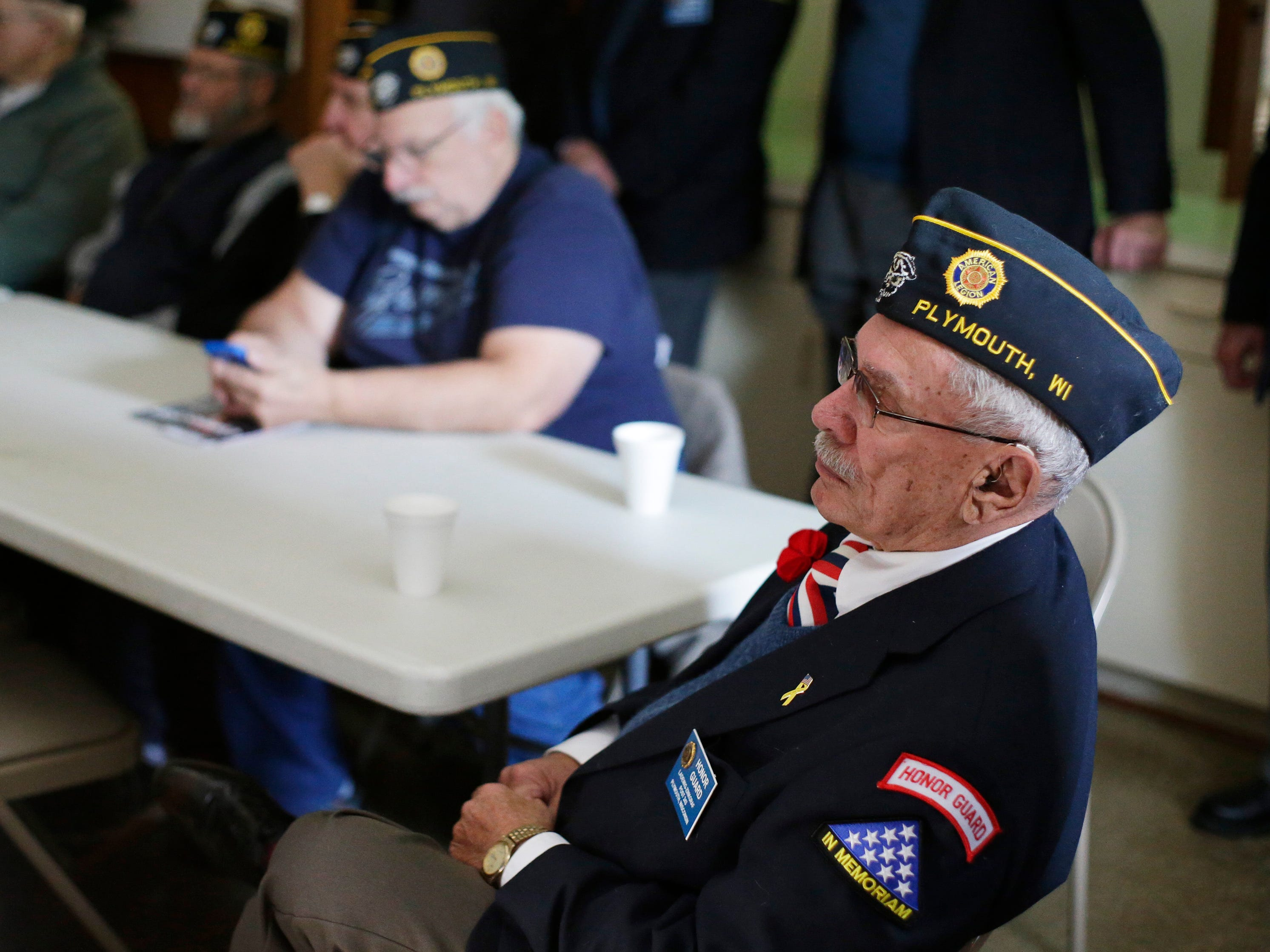 Members of American Legion, Ladwig-Zinkgraf Post 243, listen to the Pearl Harbor Program, Friday, December 7, 2018, in Plymouth, Wis.