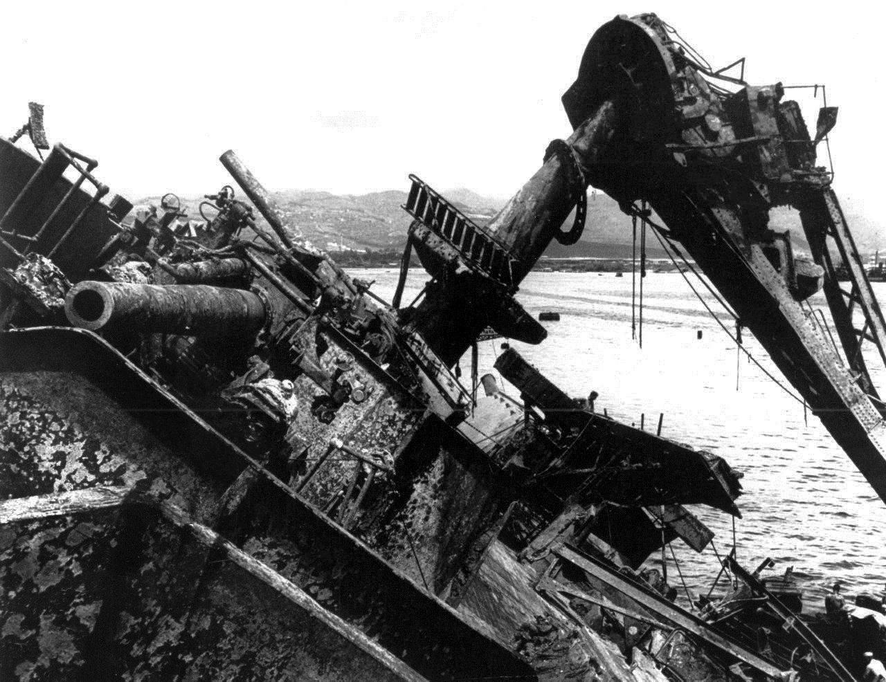 In this May 24, 1943 photo, the capsized battleship USS Oklahoma is lifted out of the water at Pearl Harbor in Honolulu, Hawaii.