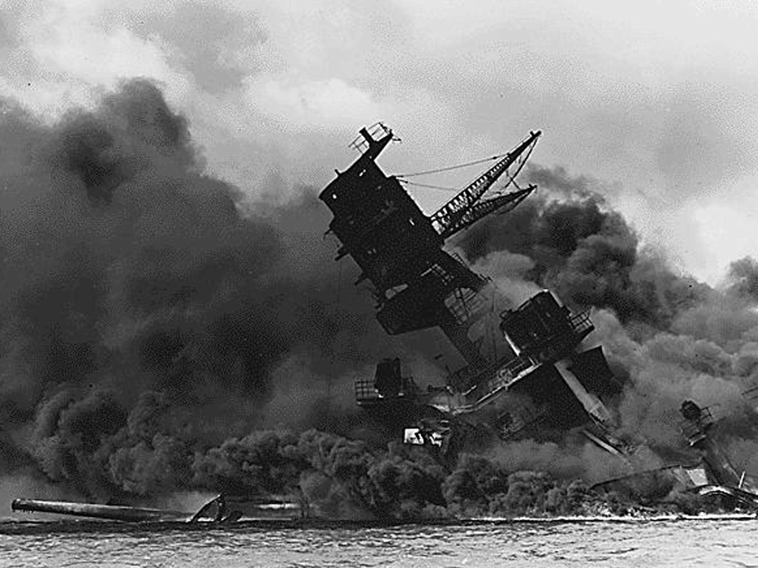 (FILES) This US Navy file image shows The USS Arizona afire and sinking after the Japanese attack on Pearl Harbor on December 7, 1941. The Arizona went down entombing 1,177 crewmembers. Seventy-five years after Japan's surprise attack on Pearl Harbor killed 2,403 Americans, a group of forensic scientists in Hawaii is still working to identify the remains of the dead. A jumble of skulls, bones and teeth deemed unidentifiable in the years following the devastating attack are now being linked to missing sailors and Marines, thanks to advances in DNA testing. / AFP PHOTO / US NAVY / HO / RESTRICTED TO EDITORIAL USE - MANDATORY CREDIT AFP PHOTO /US NAVY  - NO MARKETING - NO ADVERTISING CAMPAIGNS - DISTRIBUTED AS A SERVICE TO CLIENTSHO/AFP/Getty Images
