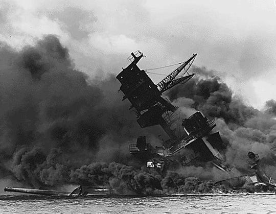 (FILES) This US Navy file image shows The USS Arizona afire and sinking after the Japanese attack on Pearl Harbor on December 7, 1941. 