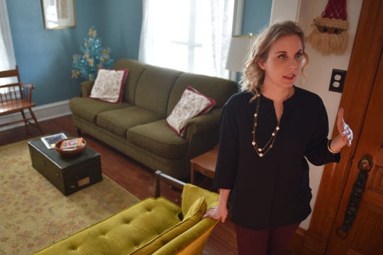 Rachael Meyerink, the head of the city's Historic Preservation board, gives a tour of her historic home Friday, Dec. 7, in Sioux Falls.