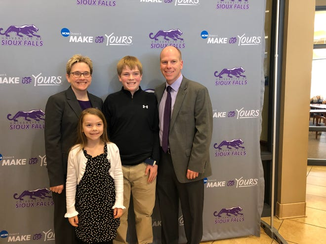 University of Sioux Falls director of athletics Pam Gohl (left) poses for a photo with her husband, Eric, and their children, Carson (middle) and Cate.