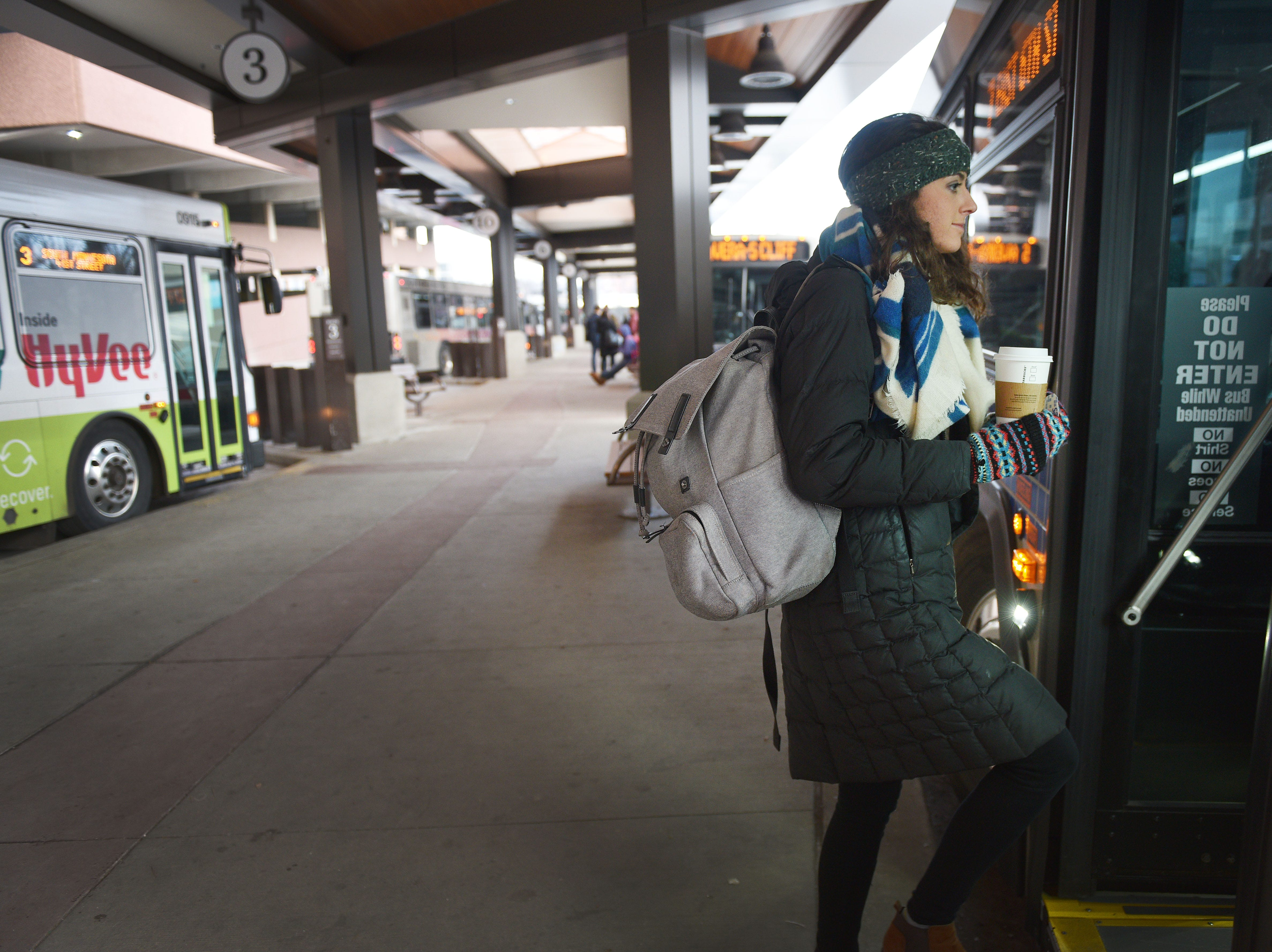 Program Associate at Centre for Public Impact Paige Mcdermott gets on a city bus Friday, Dec. 7, in Sioux Falls. Public transit costs taxpayers millions each year. That's why a task force has been set up to study the issue with assistance from staff at the Harvard Bloomberg Institute. A part of the task force's work is engaging bus riders and the general public, so members were at the bus depot at 9 a.m. Friday to talk to riders and ride the buses.