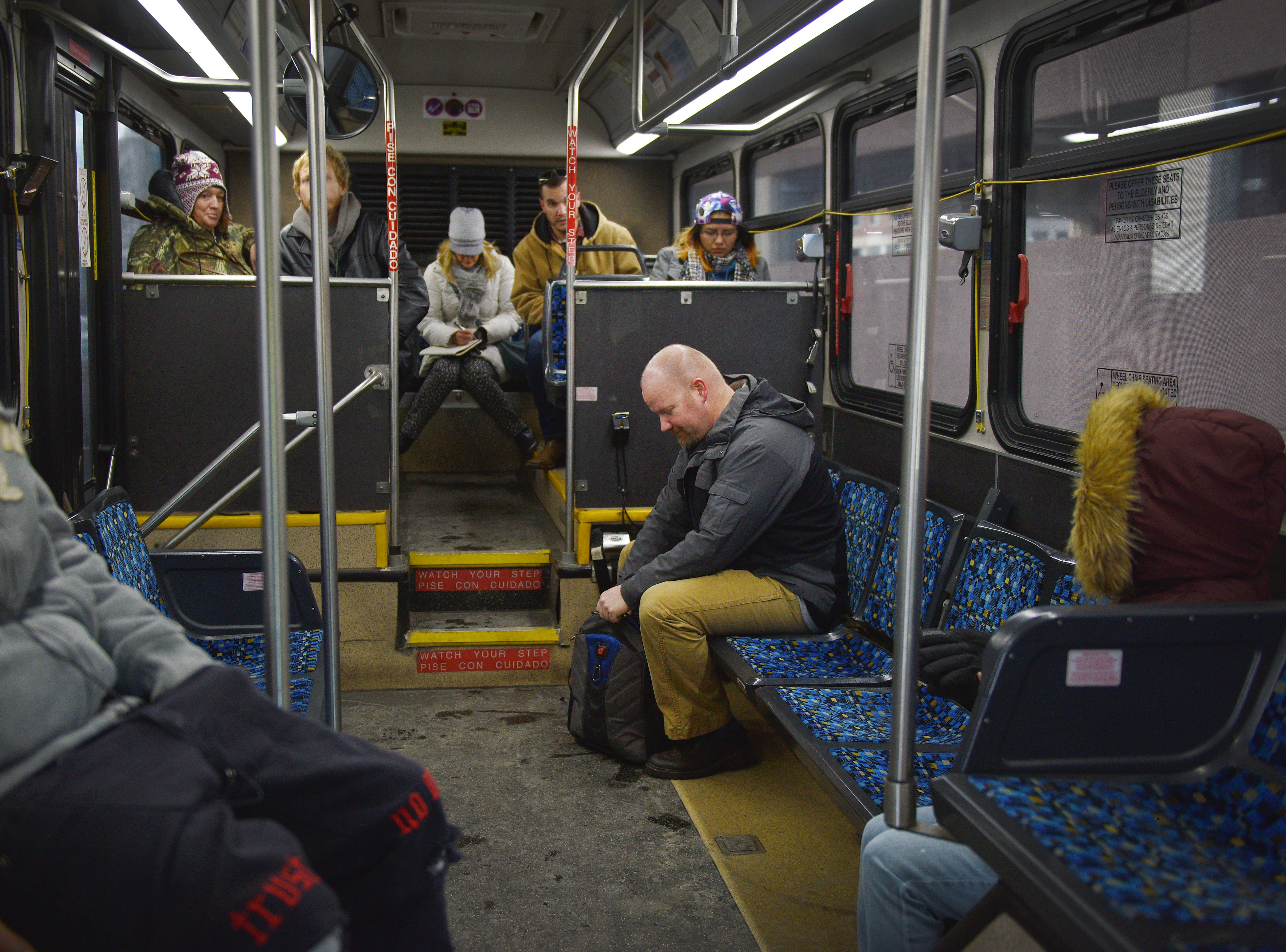 Traffic services Sergeant Kevin Henkel, right, gets on a city bus Friday, Dec. 7, in Sioux Falls. Public transit costs taxpayers millions each year. That's why a task force has been set up to study the issue with assistance from staff at the Harvard Bloomberg Institute. A part of the task force's work is engaging bus riders and the general public, so members were at the bus depot at 9 a.m. Friday to talk to riders and ride the buses.