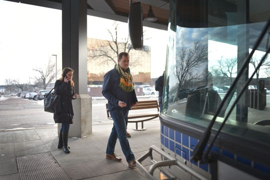 Neighborhood services coordinator Adam Roach and Harvard Bloomberg Institute Katie Appel Duda get on a city bus Friday, Dec. 7, in Sioux Falls. Public transit costs taxpayers millions each year. That's why a task force has been set up to study the issue with assistance from staff at the Harvard Bloomberg Institute. A part of the task force's work is engaging bus riders and the general public, so members were at the bus depot at 9 a.m. Friday to talk to riders and ride the buses.