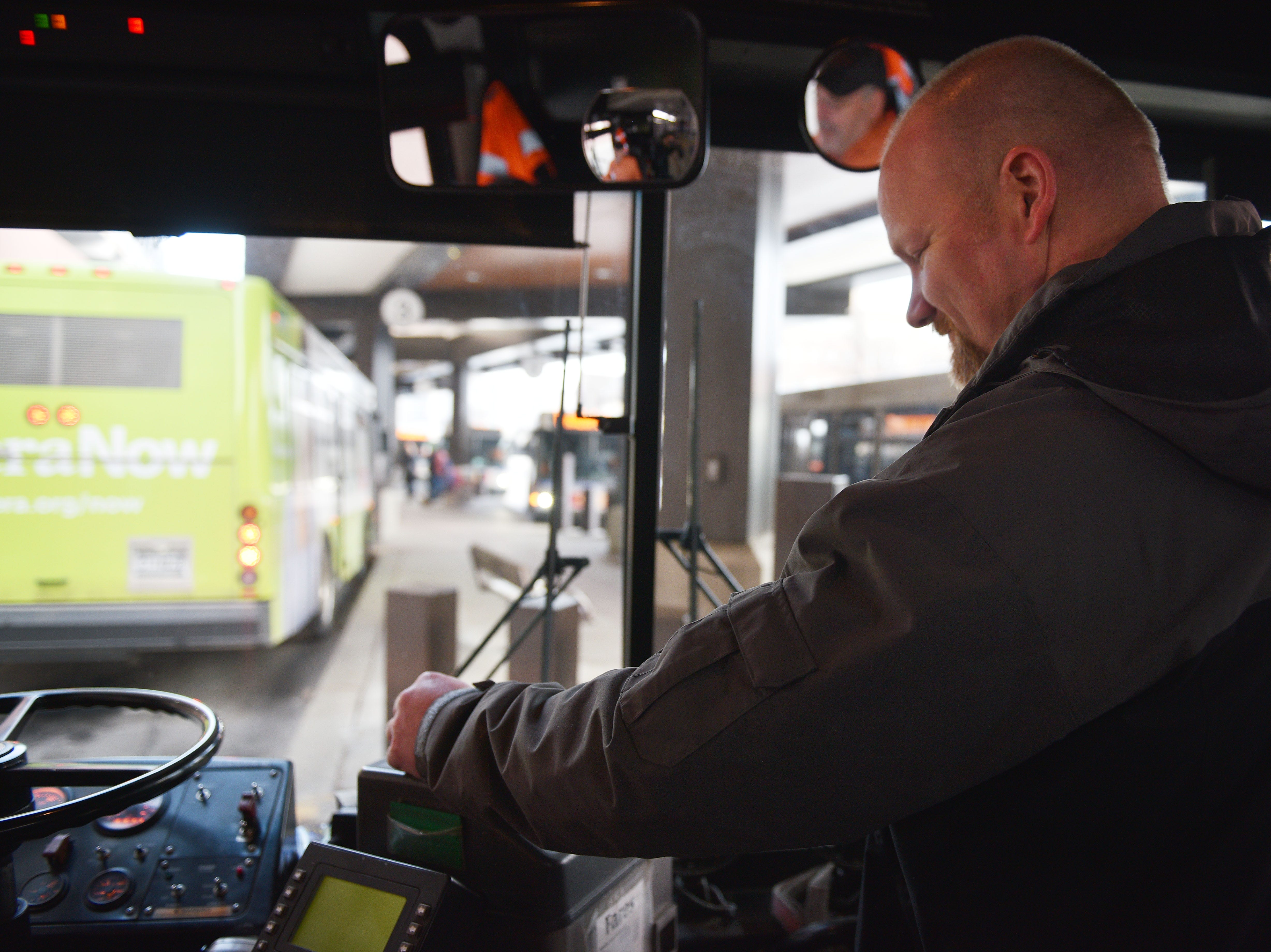 Traffic services Sergeant Kevin Henkel inserts his ticket to ride the public bus system Friday, Dec. 7, in Sioux Falls. Public transit costs taxpayers millions each year. That's why a task force has been set up to study the issue with assistance from staff at the Harvard Bloomberg Institute. A part of the task force's work is engaging bus riders and the general public, so members were at the bus depot at 9 a.m. Friday to talk to riders and ride the buses.
