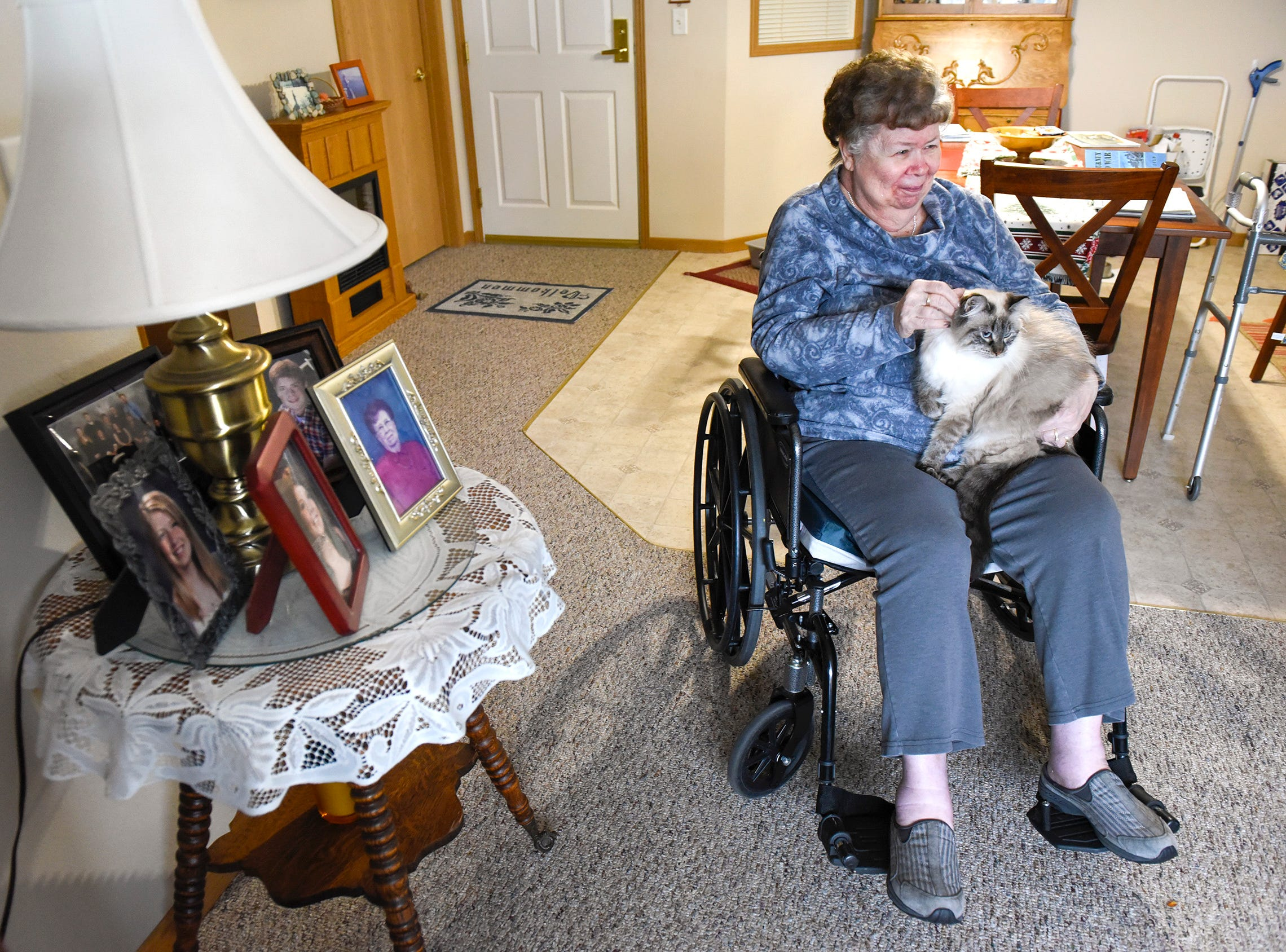 Barb Nelson holds her cat, Lena, Wednesday, Dec. 5, at Ridgeview Place Senior Living in Sauk Rapids.