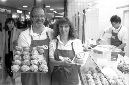 Chuck and Janet Wheeler are pictured in front of Mom's Cinnamon Rolls in Jan. 1989, after opening the business at Crossroads Center in St. Cloud.