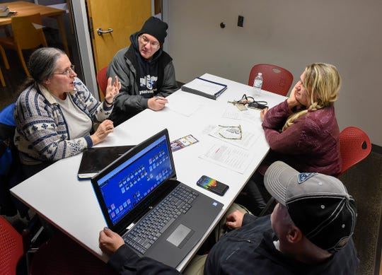 The Tree Shakers genealogy club talks about what they have found Thursday, Dec. 6, and offer suggestions to other group members working their genealogy during a meeting at the St. Cloud Public Library.