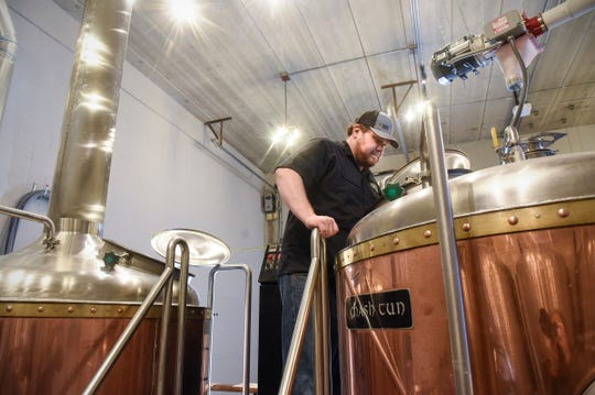 Head brewer Nick Flies checks on a fresh batch of beer in brewing equipment originally in use at O'Hara's and now installed at Pantown Brewing Company in St. Cloud.